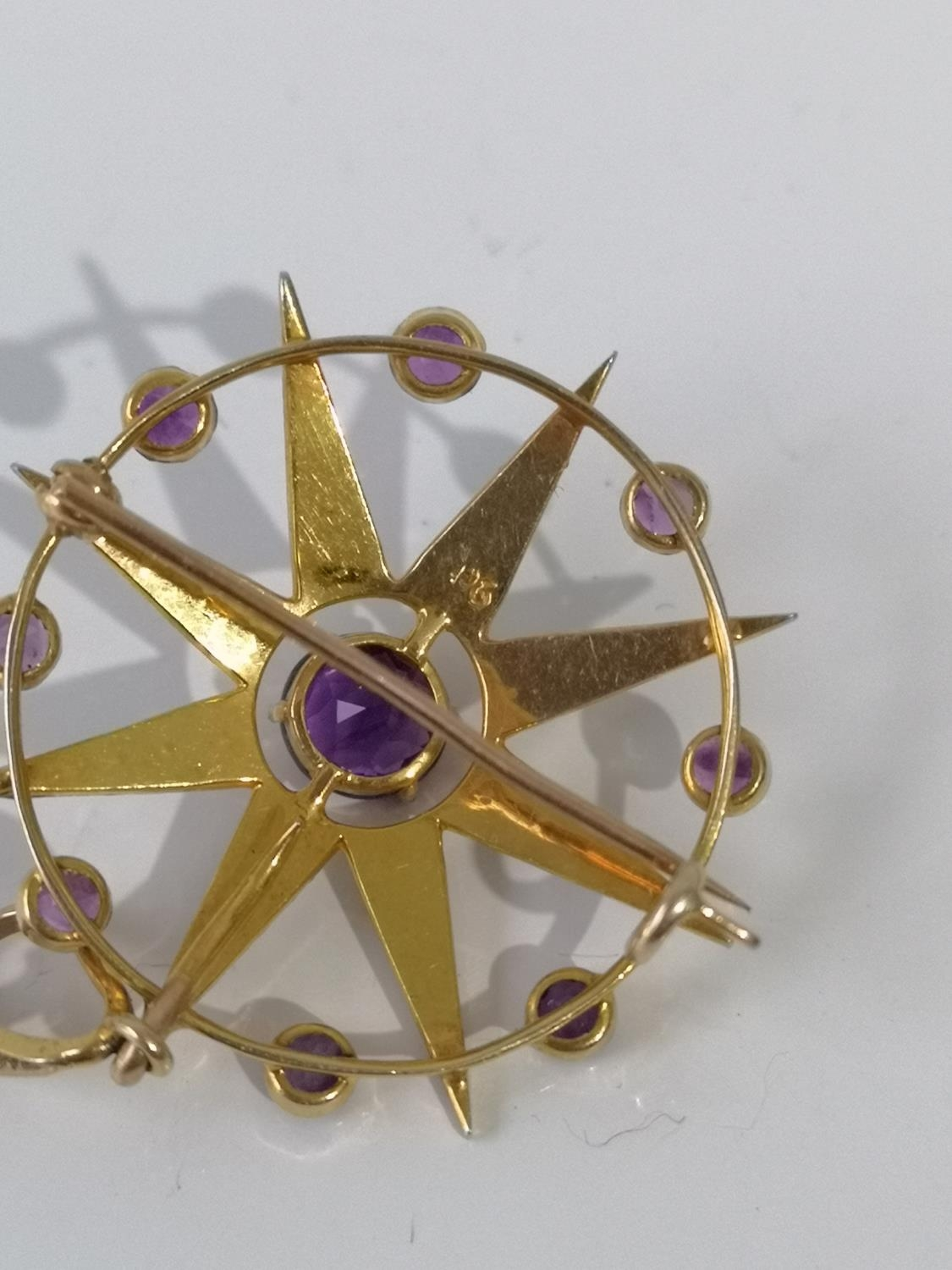 A LATE VICTORIAN SUFFRAGETTE 9CT GOLD MARKED, PEARL AND AMETHYST STAR AND CIRCLET BROOCH/PENDANT. - Image 3 of 4