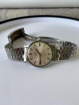 A vintage gents Omega Geneve watch, fitted with a Seiko strap, in a working condition