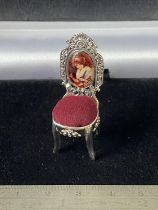 A Silver chair pincushion with enamel plaque [4.5cm in height]