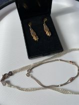 A pair of ornate 925 silver two tone clip-on earring set with garnets, silver bracelet with
