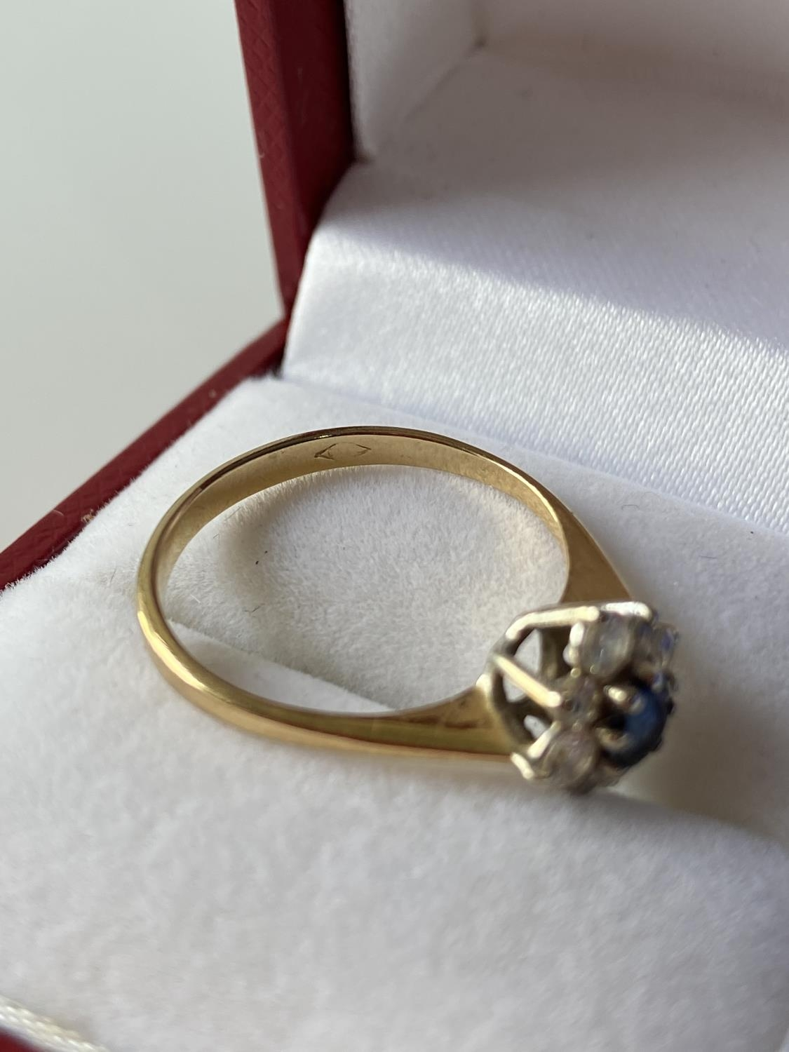 A ladies gold [possibly 18ct] ring set with a single sapphire & diamond ring, surrounded by 8 - Image 9 of 12