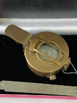 A Brass cased military style compass.