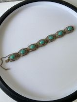 A silver filigree & turquoise stone bracelet [length 18cm]