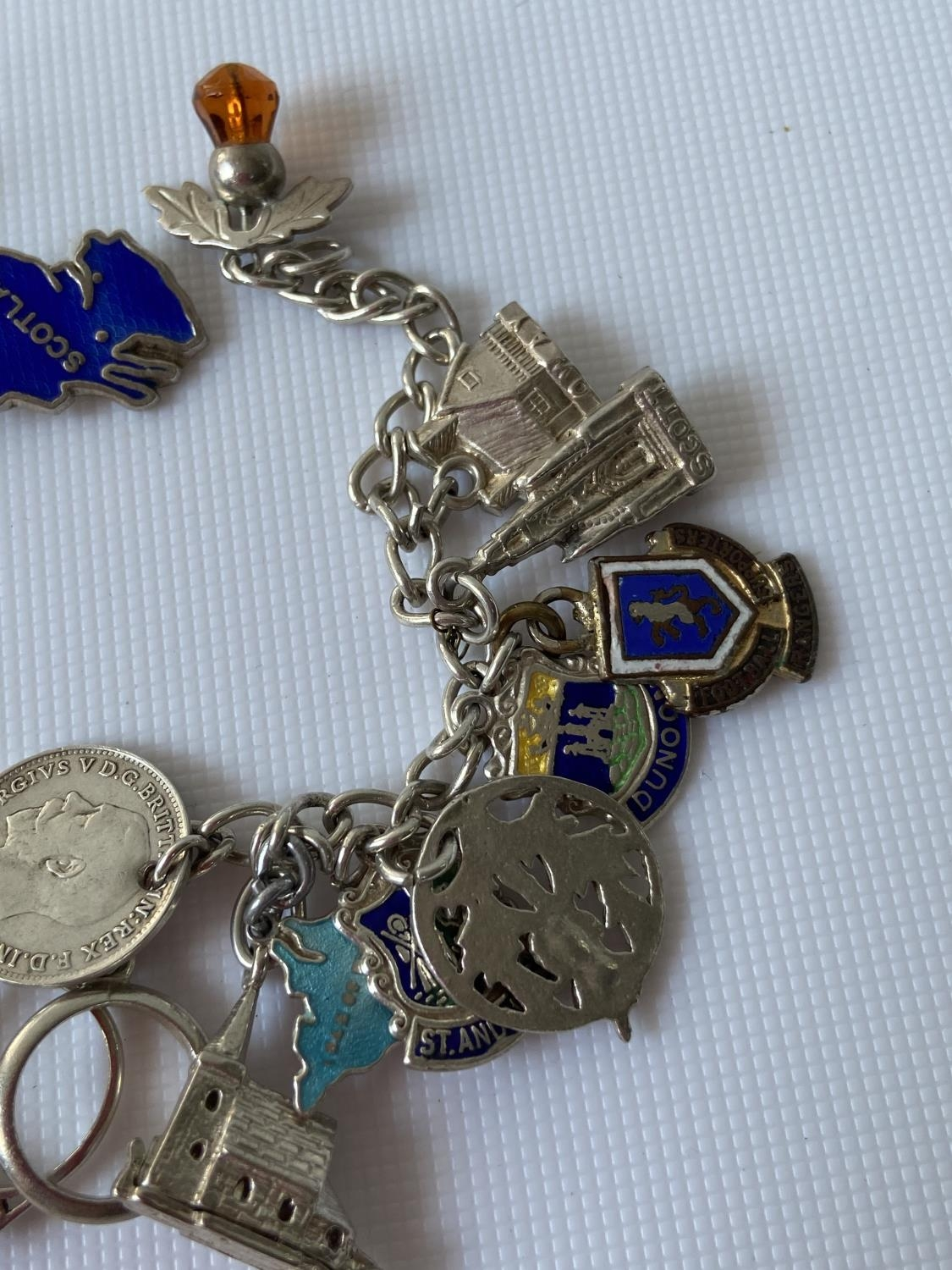 A silver charm bracelet fitted with 23 various silver chains, includes silver & enamel charms [ - Image 7 of 8