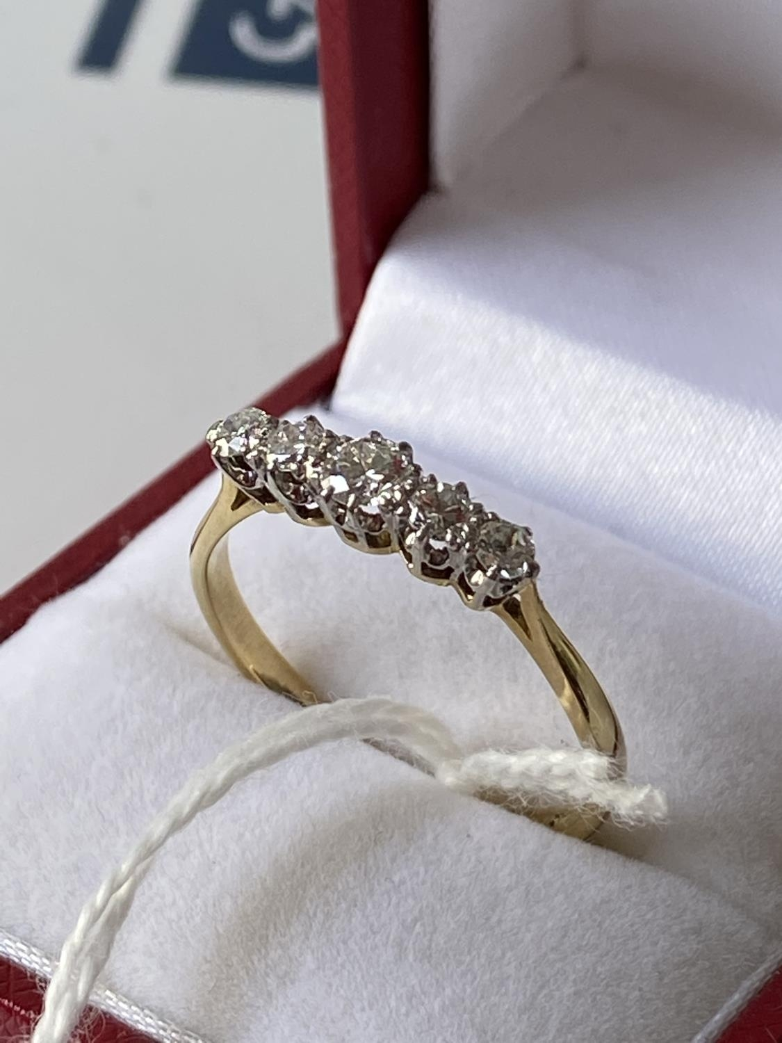 An 18ct gold ladies ring set with 5 brilliant white diamonds [1 inclusion] [size T] [2.73g] - Image 3 of 10