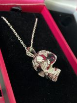 A Silver and CZ Skull head pendant with necklace.