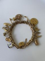 A nice example of a vintage 9ct gold heavy charm bracelet to include; 14ct gold USA golf association