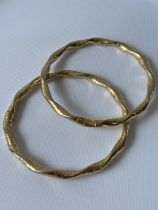 A pair of 9ct gold dolphin design bangles [9.95g]