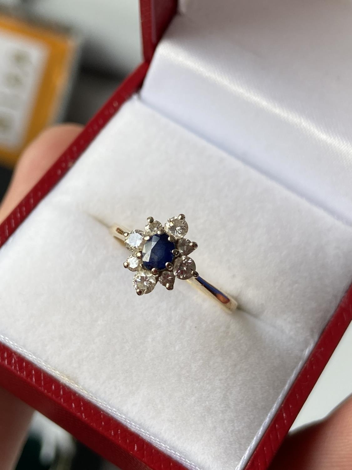 A ladies gold [possibly 18ct] ring set with a single sapphire & diamond ring, surrounded by 8 - Image 5 of 12