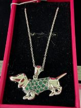 A Silver pendant necklace in the form of a sausage dog. [4.5cm nose to tail]