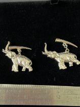 A Pair of silver elephant cufflinks.