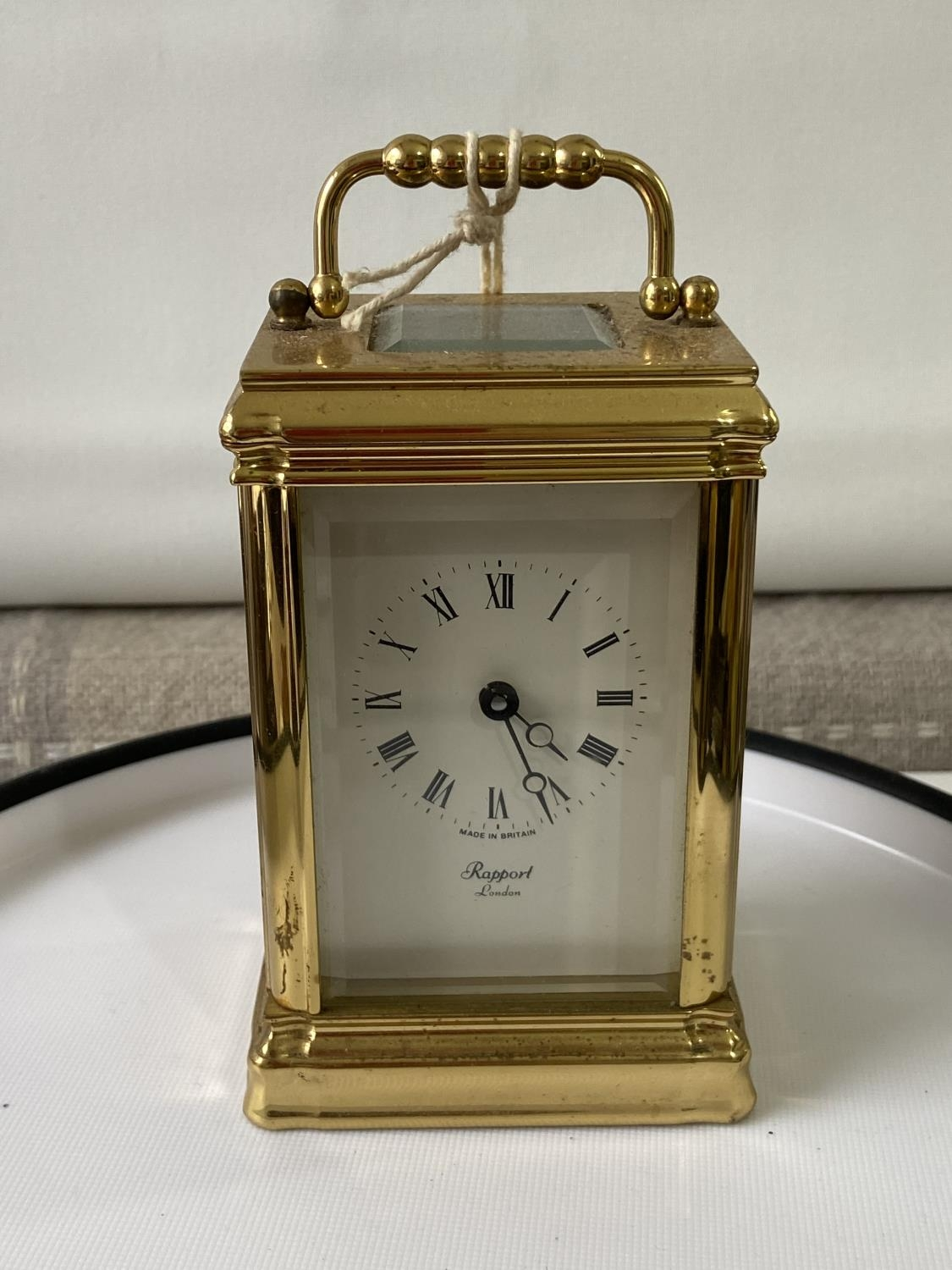 Antique heavy brass carriage clock [Rapport London] [MVT No 1800] in a working condition and with