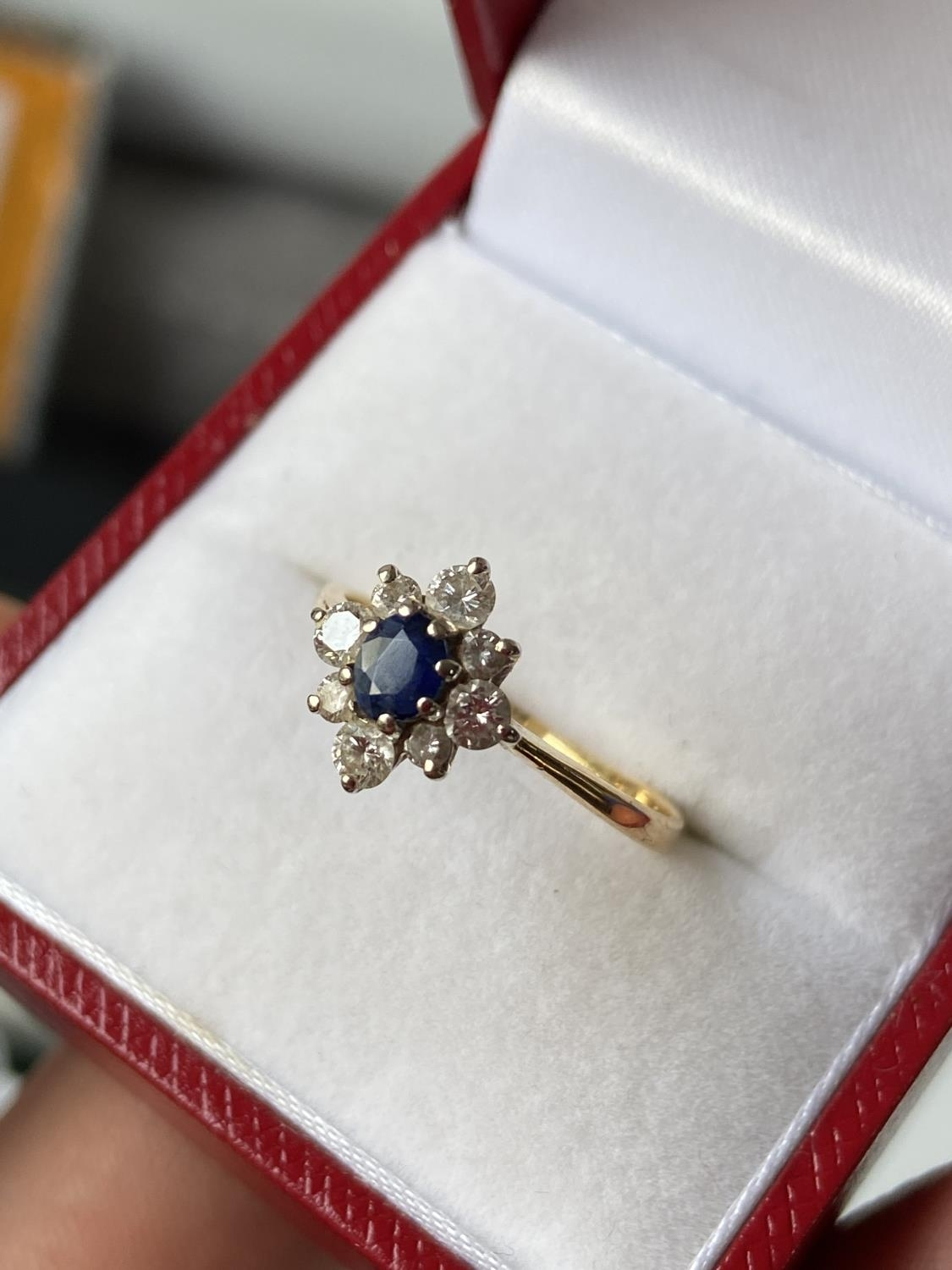 A ladies gold [possibly 18ct] ring set with a single sapphire & diamond ring, surrounded by 8 - Image 2 of 12