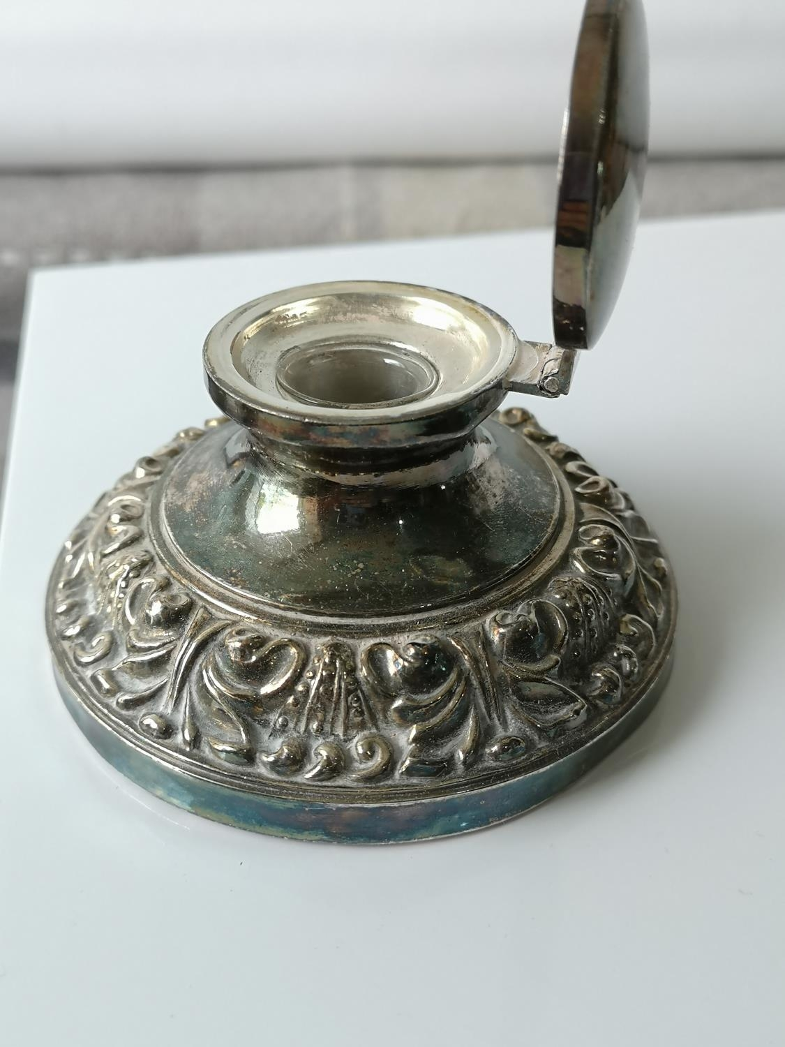 An antique ornate white metal/ plated ink well pot with glass insert. [5.5x9.5x9.5cm] - Image 3 of 3