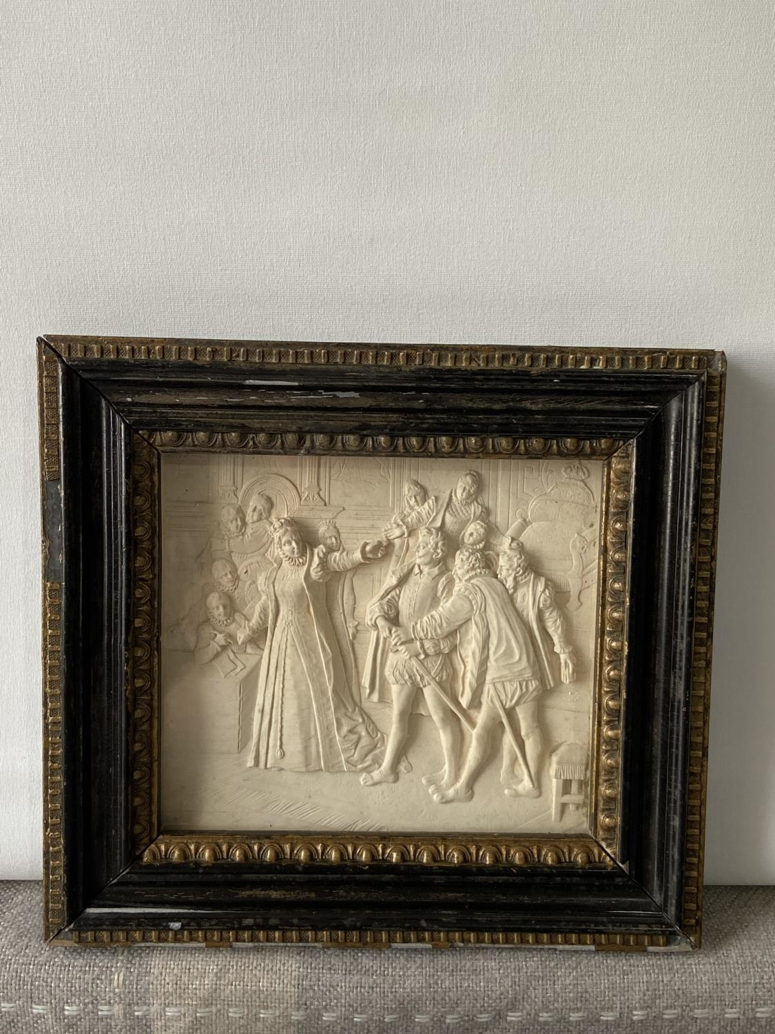 An 18th/ 19th century marble carved panel fitted within a gilt wooden frame. Depicting Queen