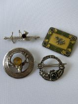 A Glasgow silver stag & citrine brooch, Sterling silver sword brooch, pewter Celtic brooch and a