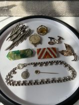 Various vintage & antique jewellery to include; two art deco bakelite buckles, gold on silver