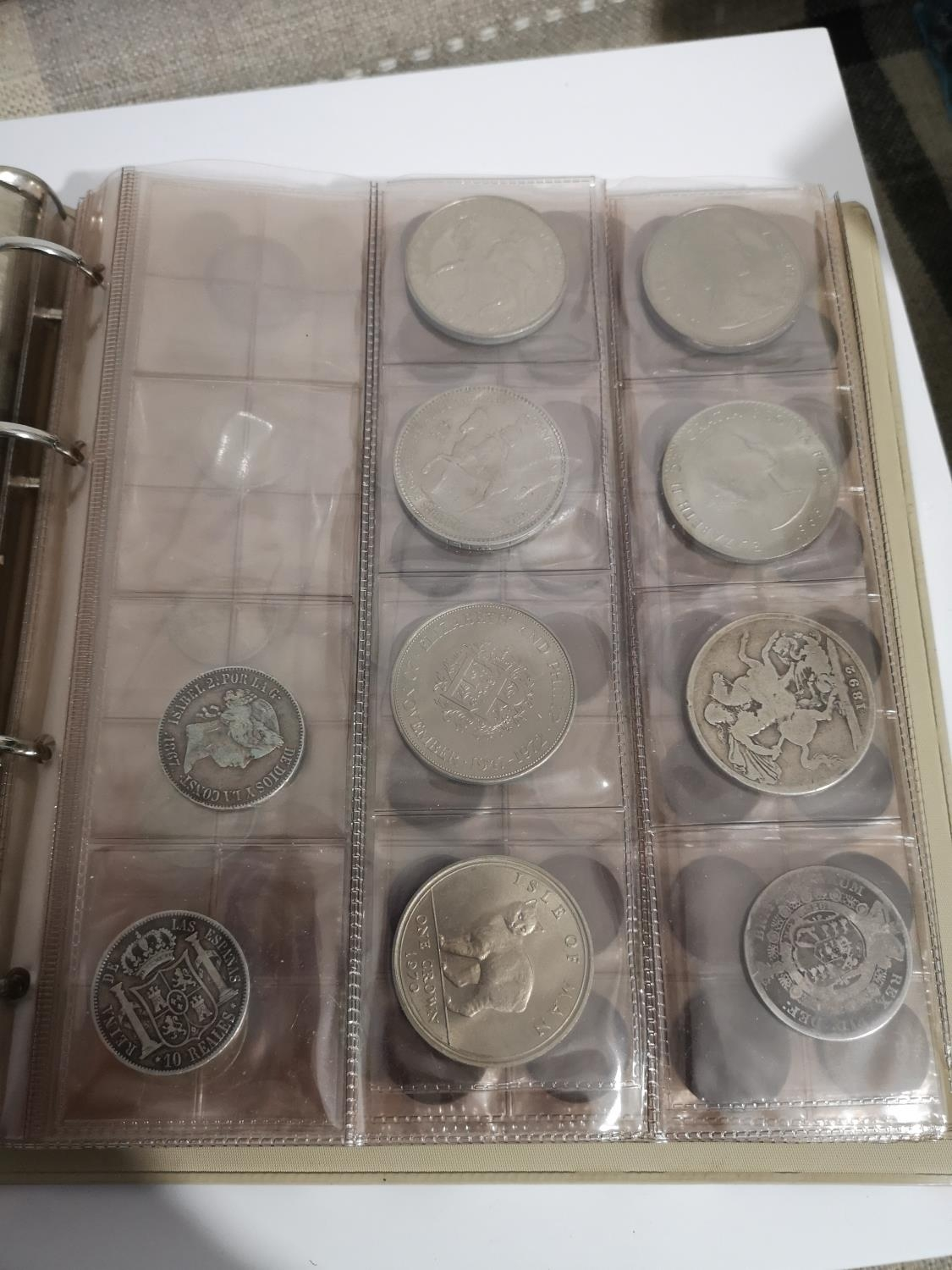 AN ALBUM CONTAINING A QUANTITY 0F 19TH AND 20TH CENTURY COINS TO INCLUDE TWO SPANISH ISABELL II