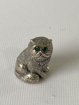 A silver figure of a cat with emerald eyes. [2.3CM IN HEIGHT]