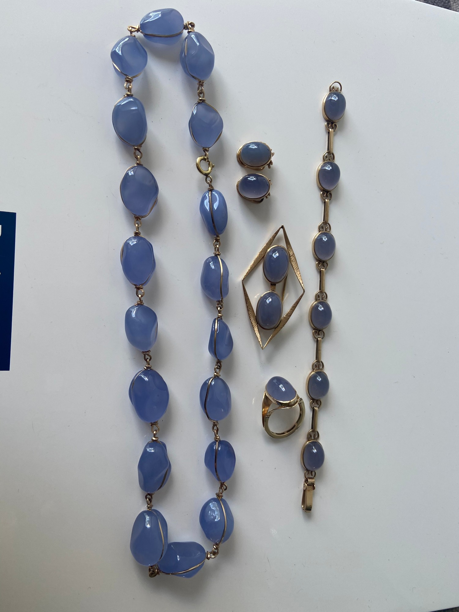 A FIVE PIECE NECKLACE, RING, BROOCH, BRACELET AND EARRING SET. ALL BEAUTIFULLY SET WITH CHALCEDONY