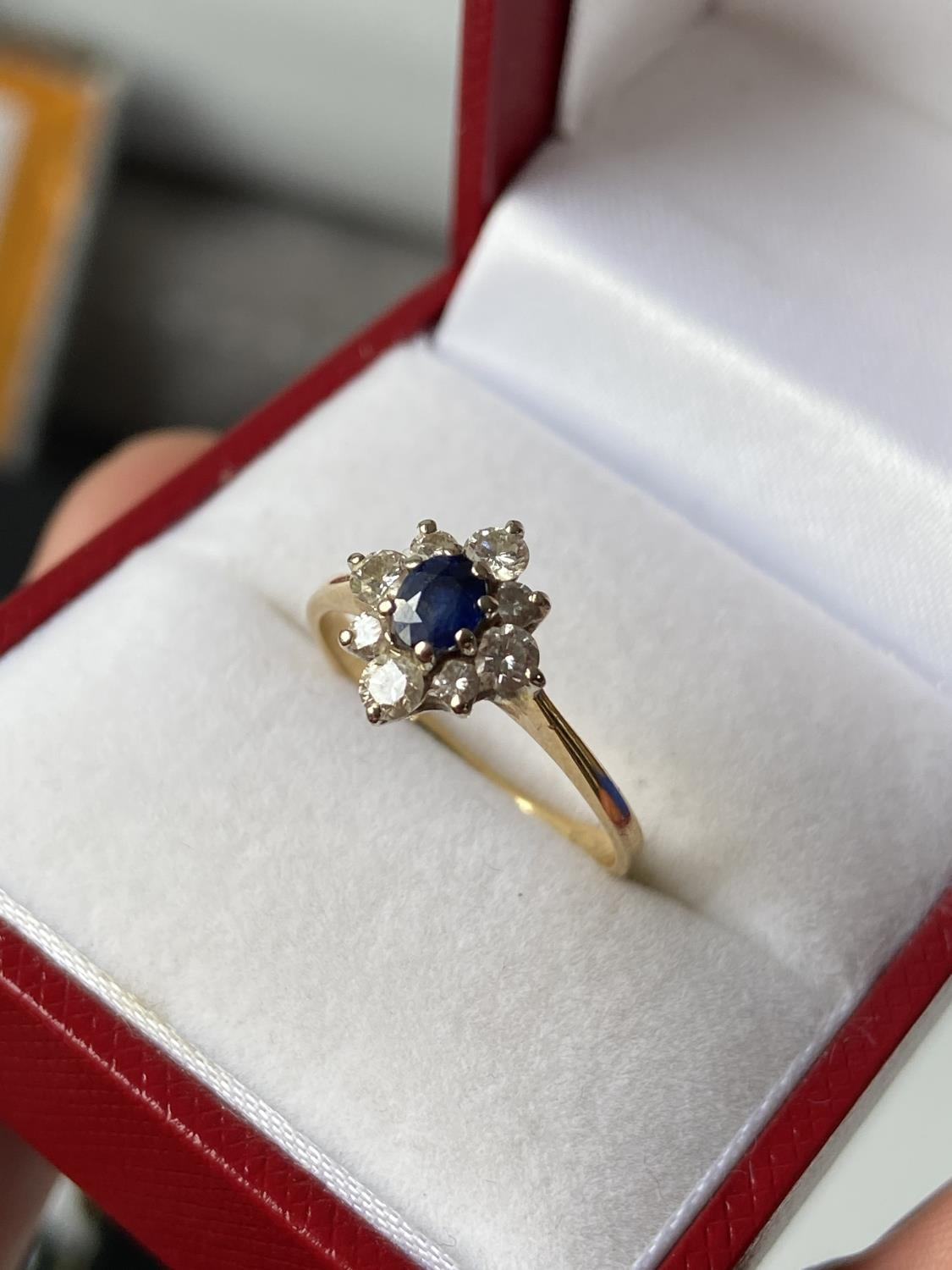 A ladies gold [possibly 18ct] ring set with a single sapphire & diamond ring, surrounded by 8 - Image 3 of 12