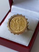 A 9ct gold ring set with a gold half sovereign, dated 1906 [size M] [9.51g]