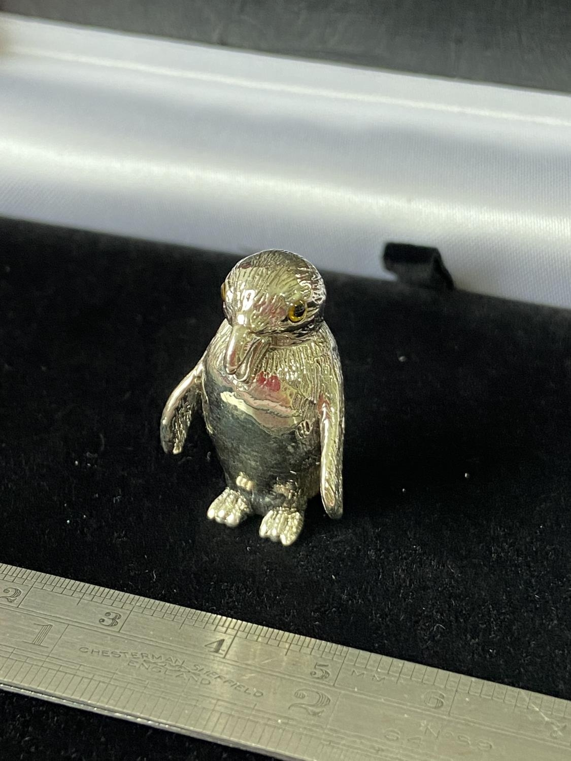 A Silver penguin pincushion with glass eyes. [2.9cm in height]