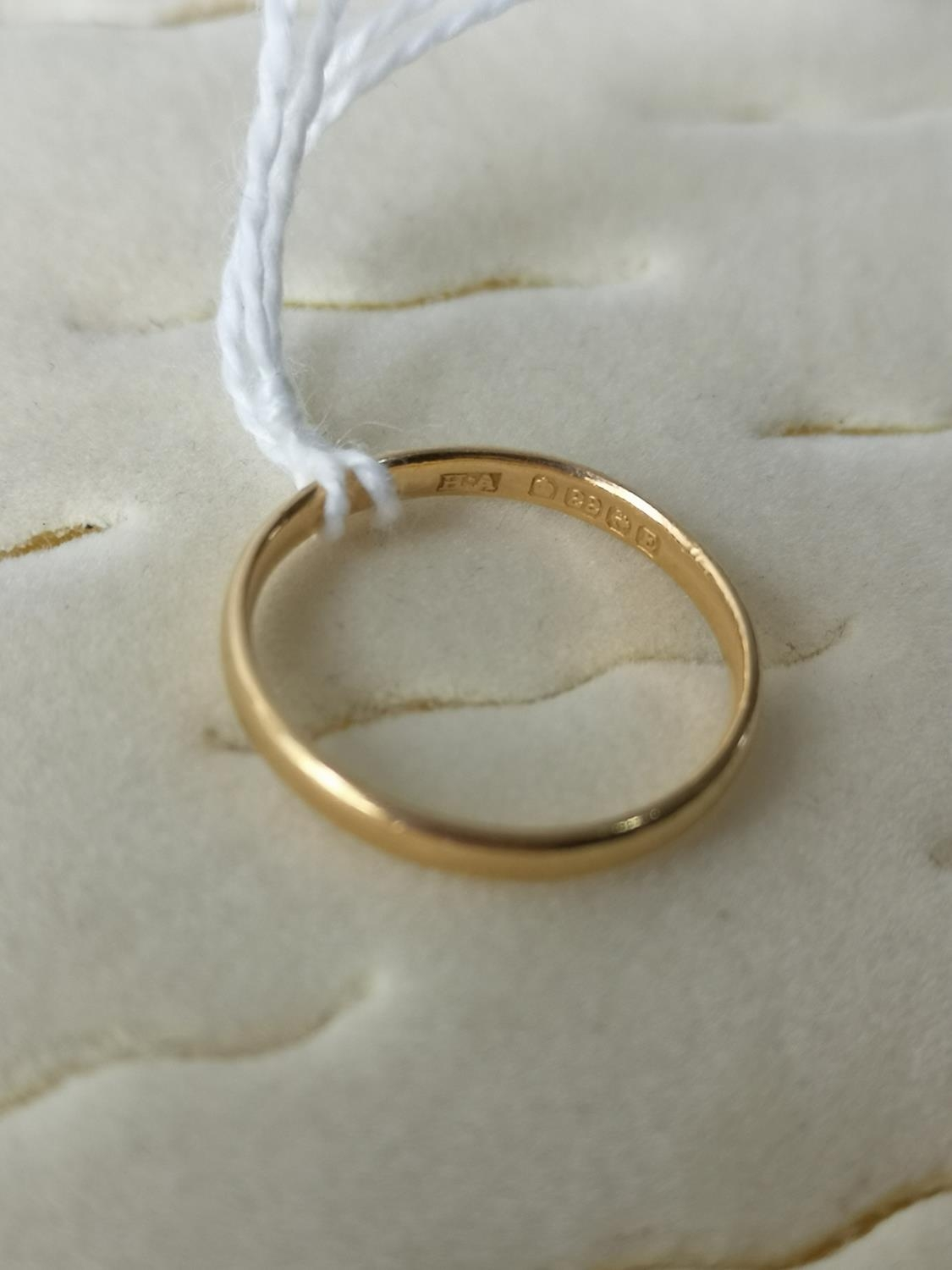 A 22ct gold wedding band [Ring size N] [2.33Grams]