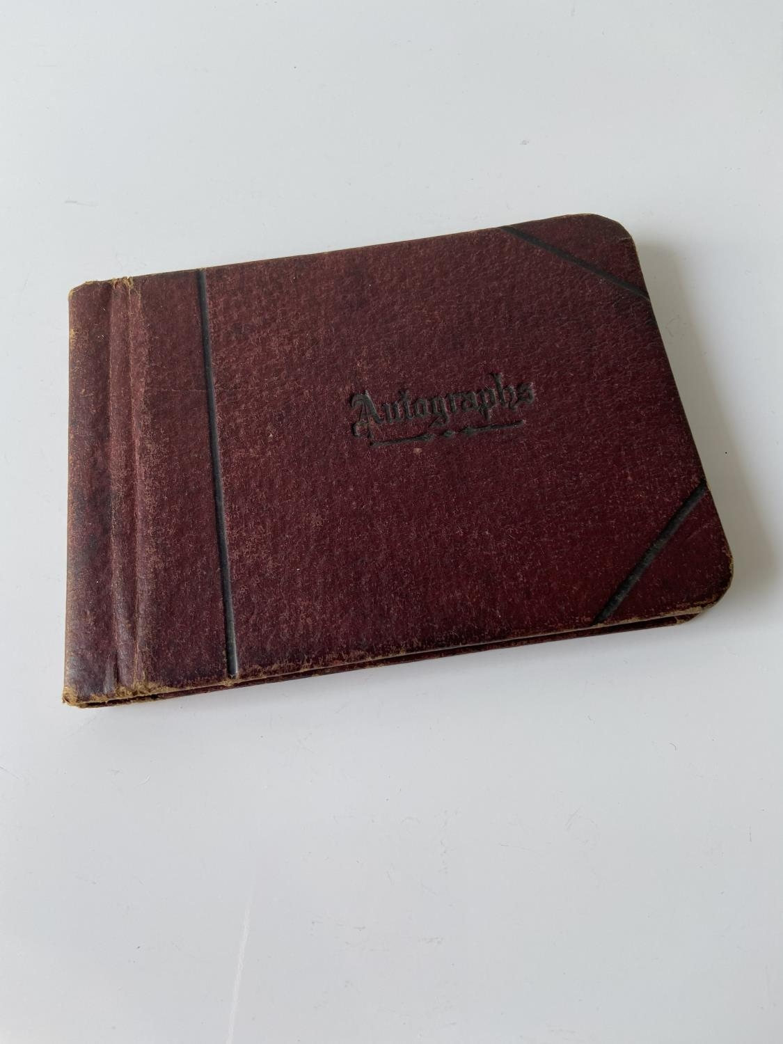 An old autograph album containing various poems, sayings & doodles