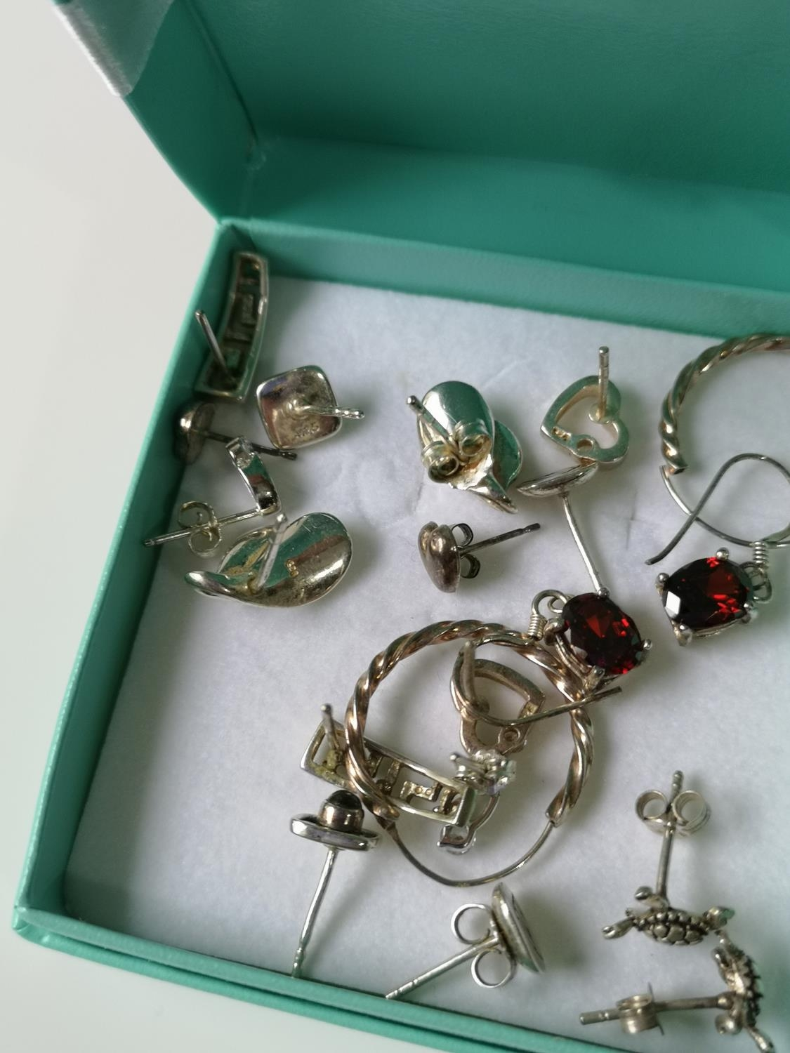 A Collection of silver marked earrings to include garnet stone set. - Image 2 of 2