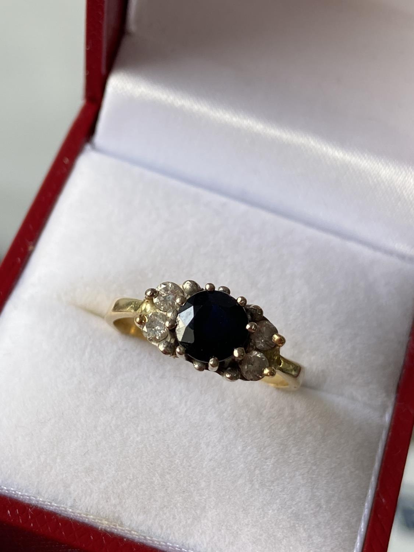 An 18ct gold ladies sapphire & diamond set ring [diameter 6mm] [size M] [2.89g] - Image 6 of 10