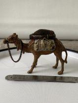 A Cold painted bronze camel pincushion. [7.5x10.5x3.5cm] [193.90grams]