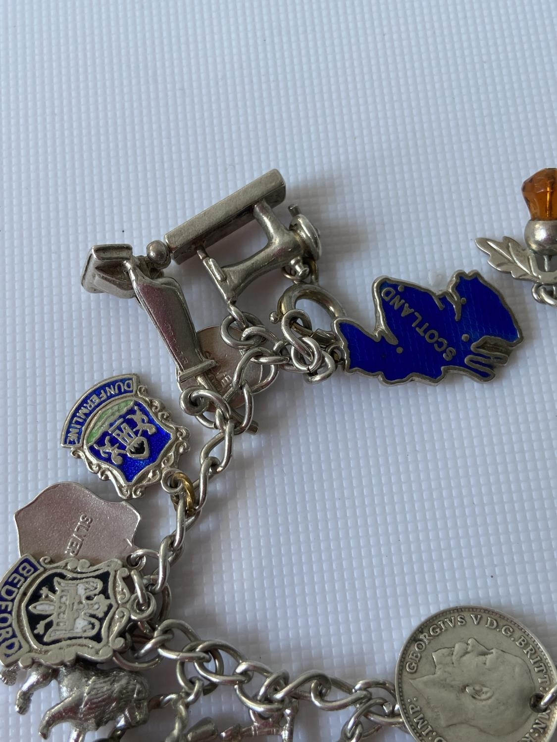 A silver charm bracelet fitted with 23 various silver chains, includes silver & enamel charms [ - Image 3 of 8