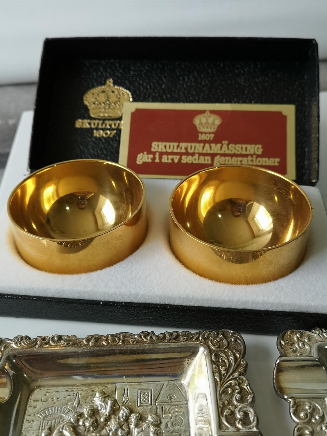 A Pair of boxed gold plated Swedish Skultuna cruet pots together with two ornate silver plated ash - Image 2 of 2