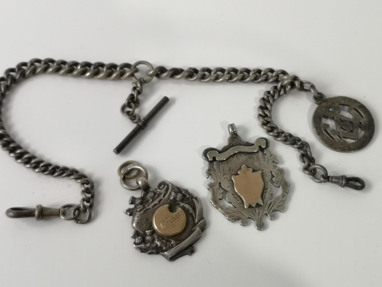 An antique silver Albert chain, T- Bar & Birmingham silver Masonic fob medal set with a blue