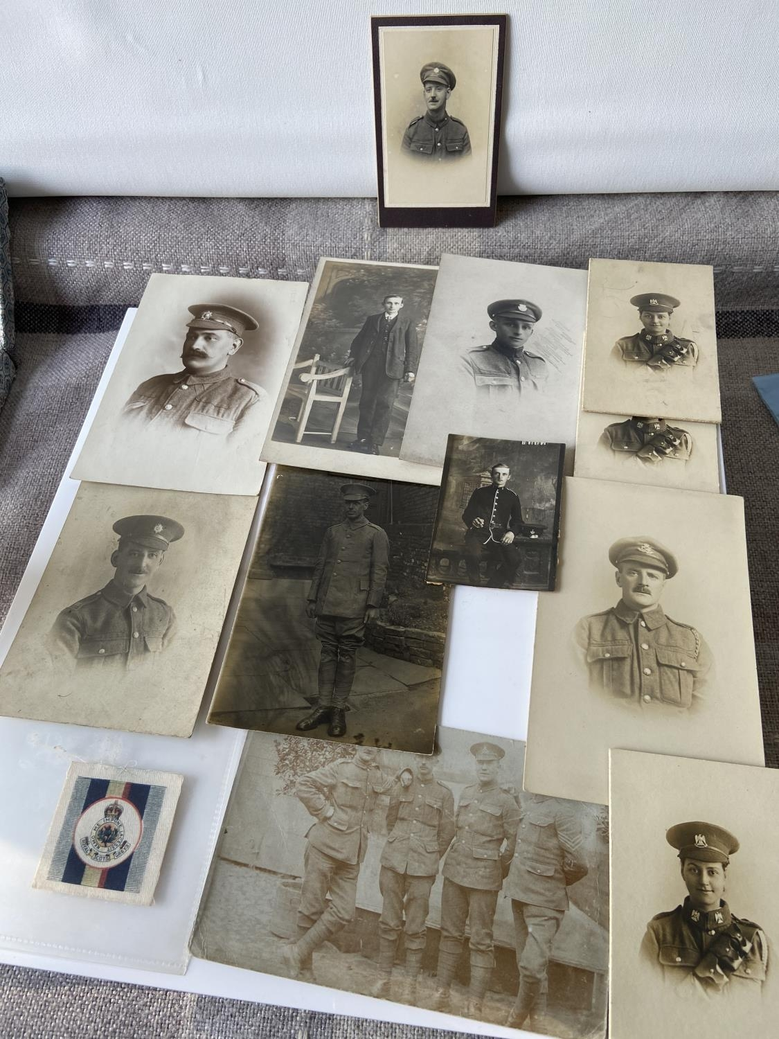 A selection of military items to include; silk Royal Scots Gray's [Happy Home], South