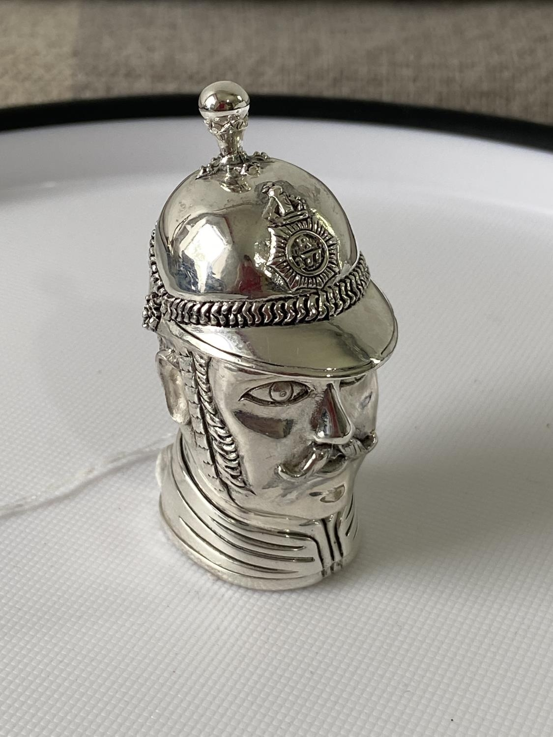 A Silver plated vesta case in the form of a policeman [6.2cm in length]