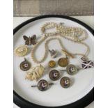 A selection of various vintage badges to include; a gold & enamel 'Soroptimist International