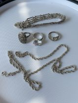 3 various silver rings, a silver gate bracelet and a silver rope necklace