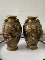 A pair of Japanese satsuma hand painted urn style cases depicting various characters & dragon design