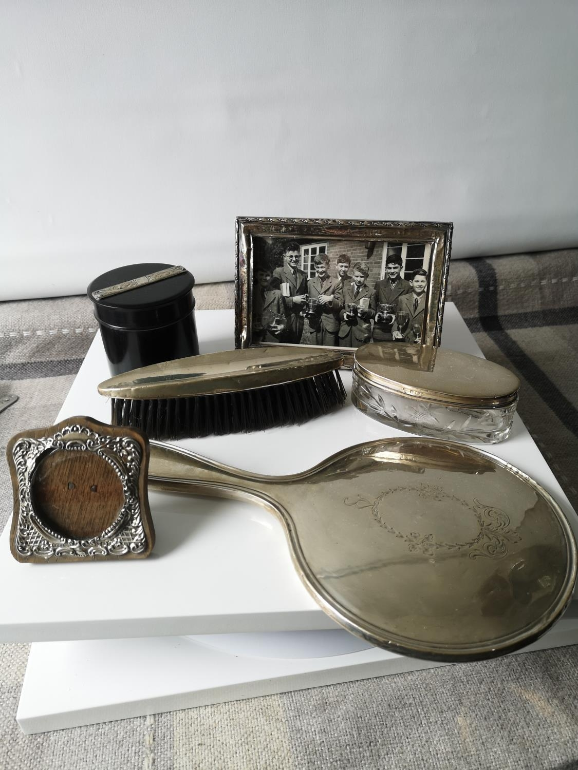 A Silver hand brush, mirror, silver lid and glass base dressing table preserve pot, ebony & silver