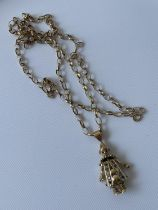 9ct gold clown pendant, together with a 9ct gold belcher chain [length 72cm] [15.2g]