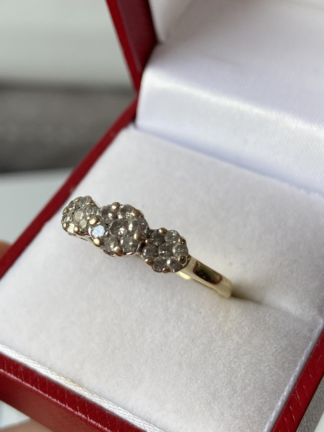 An 18ct gold [tested] diamond cluster ring [0.50ct] [size, O] [3.29g]