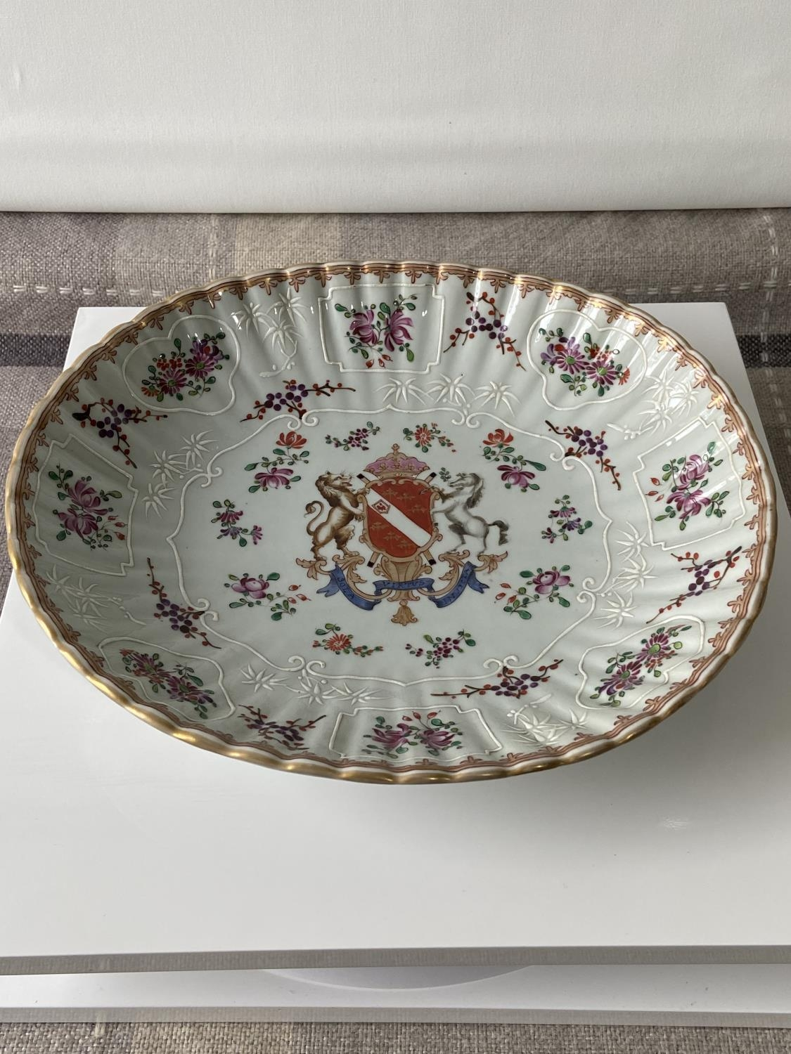 An antique Chinese/ Japanese marked hand painted bowl. Designed with a scalloped edge, flower panels
