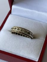 A 9ct gold band ring set with clear stones [size N] [3.45g]