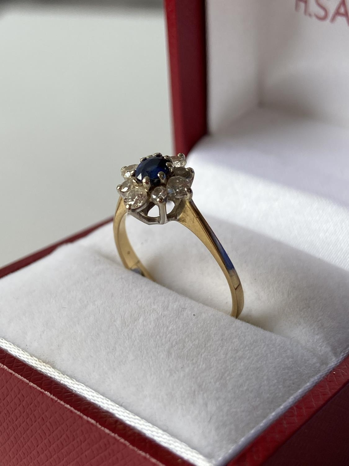 A ladies gold [possibly 18ct] ring set with a single sapphire & diamond ring, surrounded by 8 - Image 8 of 12