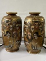 A pair of Japanese satsuma hand painted vases depicting various characters & dragon design [height