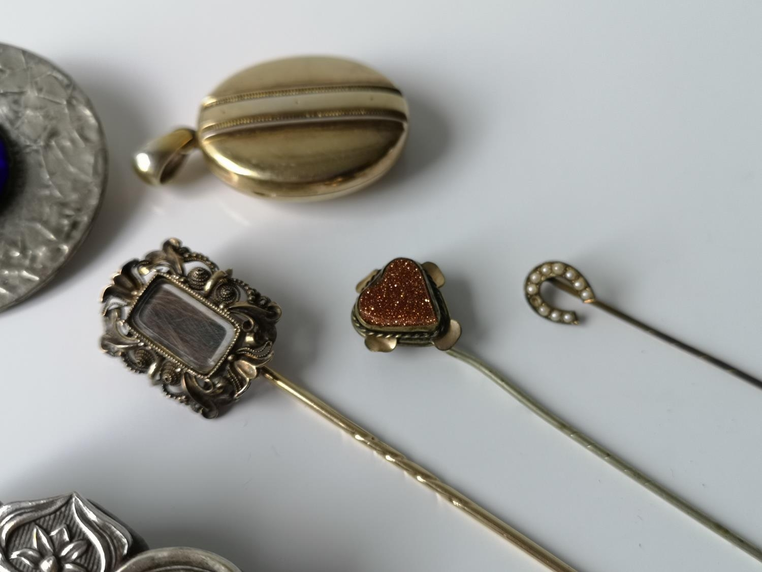 A Lot of three antique hat pins, gilt metal locket, arts & crafts blue stone brooch & a plated - Image 2 of 2