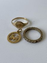 A 9ct gold cat pendant, a 9ct gold signet ring and a 9ct gold band ring (missing one stone)