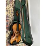 A 3/4 size violin, with one bow and case